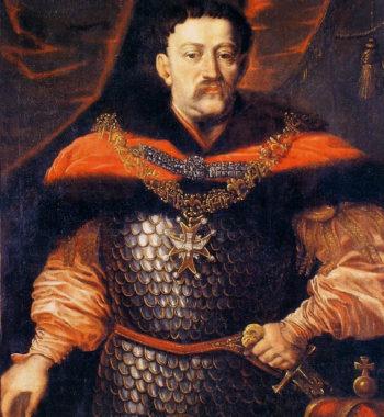 Portret mężczyzny o sumiastych wąsach, w karacenie, okrytego bogatym płaszczem, z orderem Ducha Świętego na piersi i lewą dłonią zaciśniętą na rękojeści szabli.